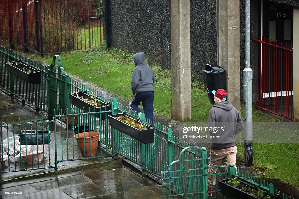Young men walk through the Falinge Estate, which has been surveyed as the most deprived area in England for a fifth year in a row, on January 8, 2013 in Rochdale, England. According to data provided by the Department for Communities and Local Government, 72 per cent of people in the local area are unemployed and seven per cent have never had a job. Four out of five children on the estate are living in poverty, with the area having one of the highest teenage pregnancy rates in the country. During today's House of Commons debate, the government urged MPs to back their planned 1 per cent cap on annual rises in benefits and some tax credits for three years from next April. Benefits for people of working age have historically risen in line with the rate of inflation.