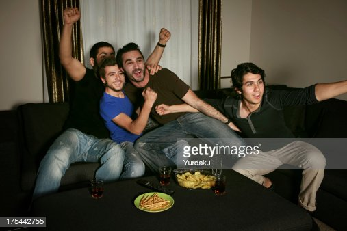 young men watching sports competition