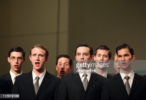 Young men's choir sings.