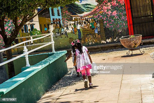 Young Mexican girls carrying water