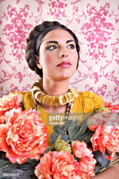 Young Mexican Woman Wearing Braid on Head Posing with Flowers