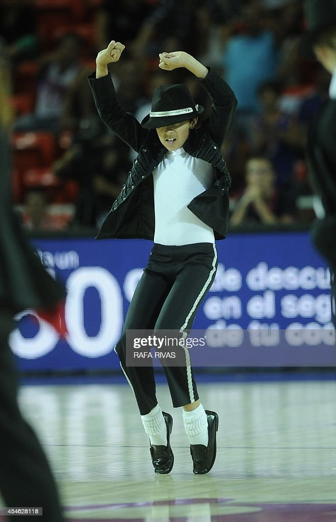 A young Michael Jackson lookalike performs during the 2014 FIBA World basketball championships group C match Turkey vs Dominican Republic at the...