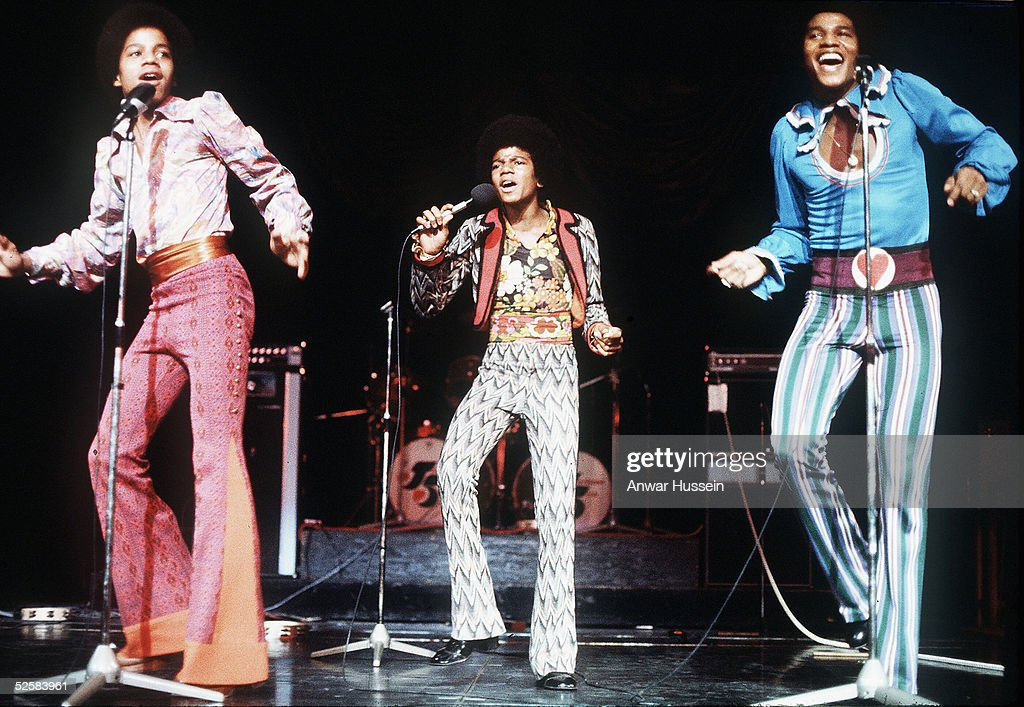 A young Michael Jackson (centre) performs live with the Jackson 5 in February 1975 in London, England.