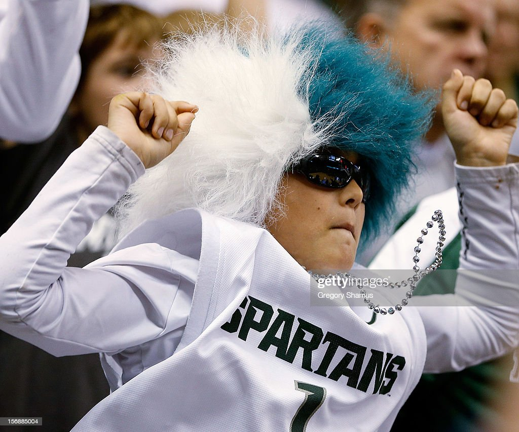 A young Michigan State Spartans fan cheers during a game against the Oakland Golden Grizzlies at the Jack T. Breslin Students Events Center on November 23, 2012 in East Lansing, Michigan. Michigan State won the game 70-52.