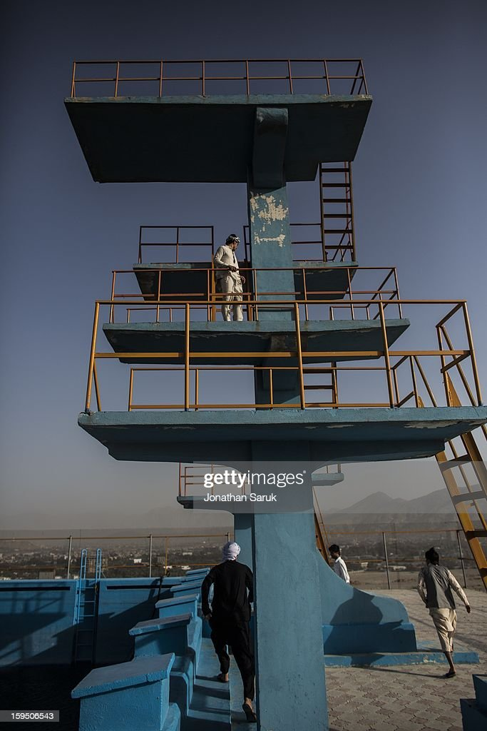 Young middle-class Afghans visit the old Russian swimming pool in the Wazir Akhbar Kahn neighborhood of Kabul July 20, 2012 in Kabul, Afghanistan.