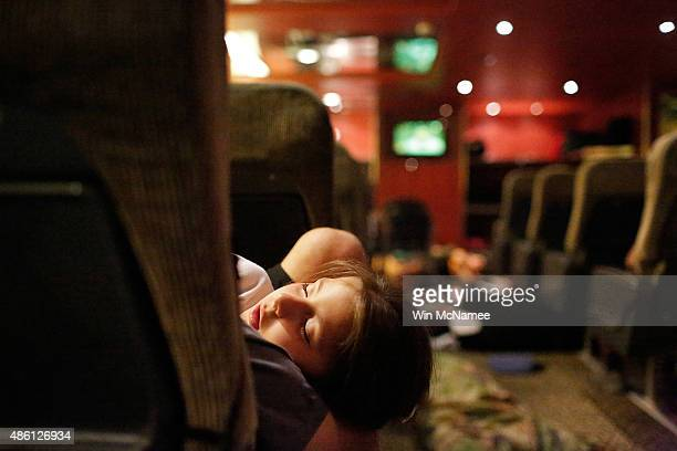 A young migrant girl from Syria sleeps onboard a Blue Star ferry during a ten hour journey from the island of Kos to the Greek mainland port of...