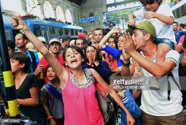 Young migrants protest at the Eastern railway station of Budapest on September 1 during the evacuation of the railway station by local police...