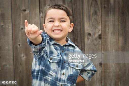 Young Mixed Race Boy Making Shaka Hand Gesture : Stock Photo