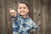 Happy Young Mixed Race Boy Making Hawaiin Shaka Hand Gesture.