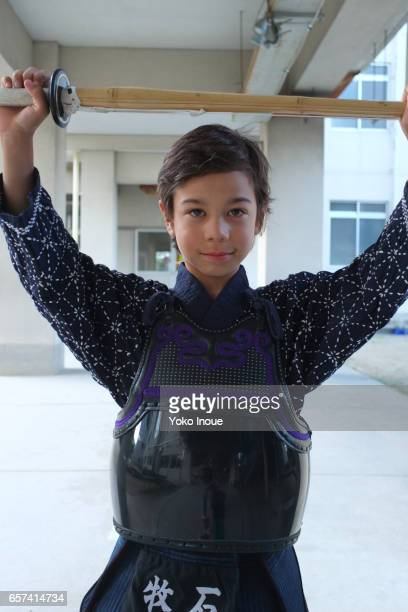 Young mixed race boy practicing Kendo