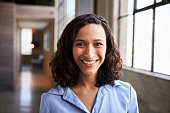 Young mixed race businesswoman smiling to camera