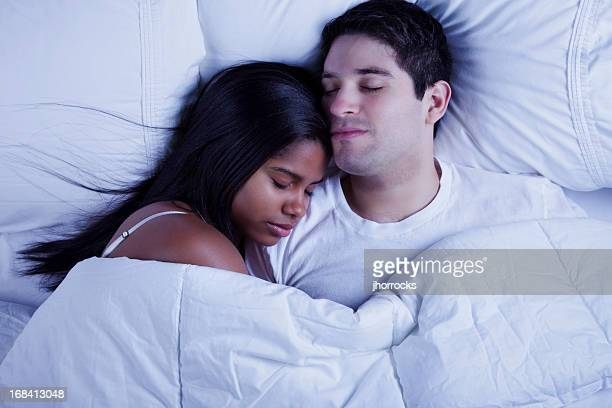 Young Mixed Race Couple Sleeping Blissfully