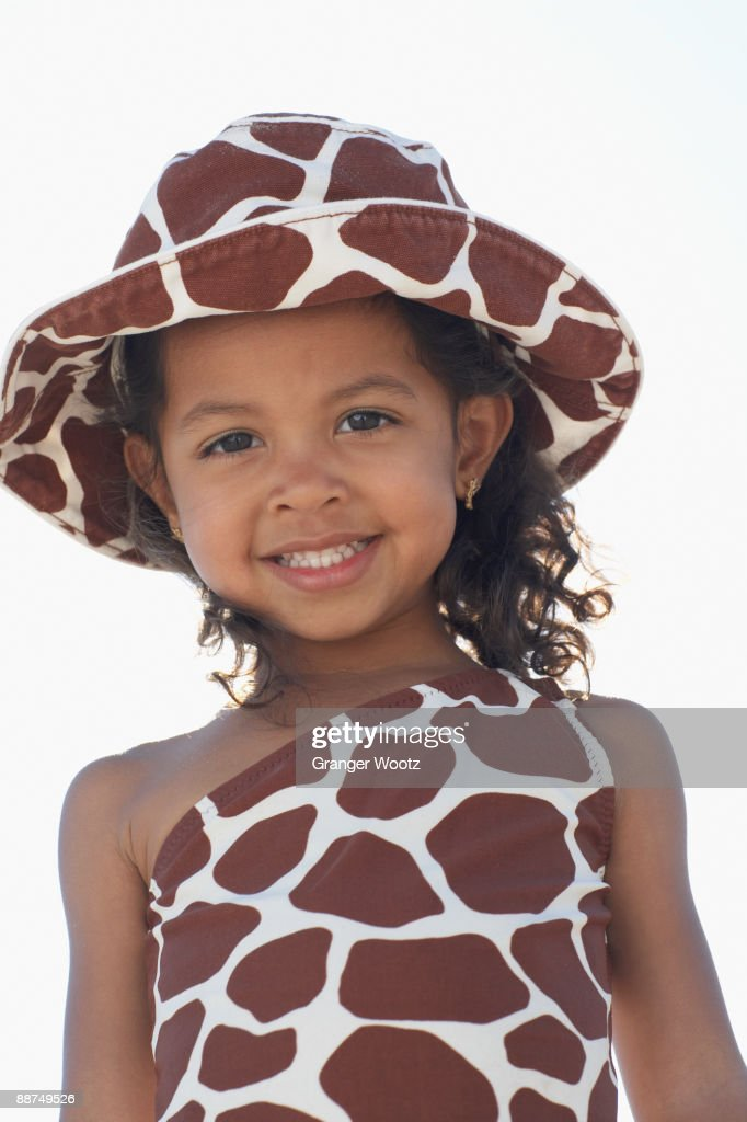 Young mixed race girl in bathing suit and hat : Stock Photo