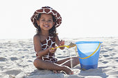 Young mixed race girl playing at beach