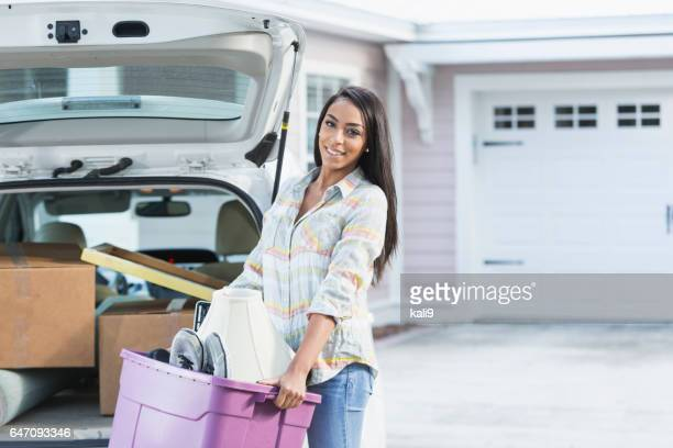 Young mixed race woman moving house
