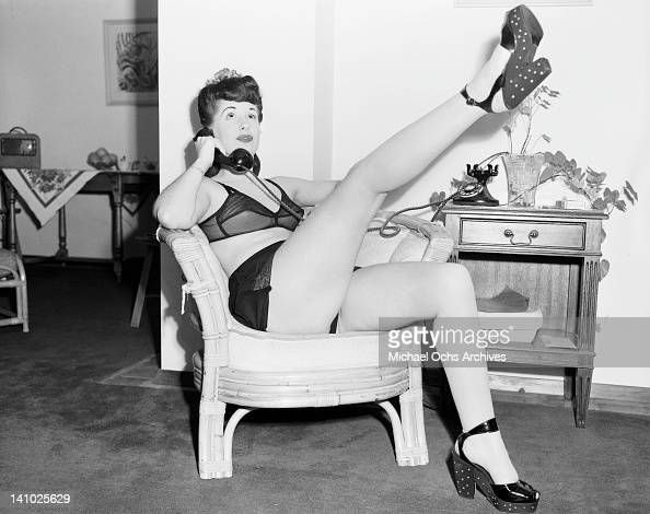 Young model Joni McKellen in a provocative pose during a phonecall circa 1948