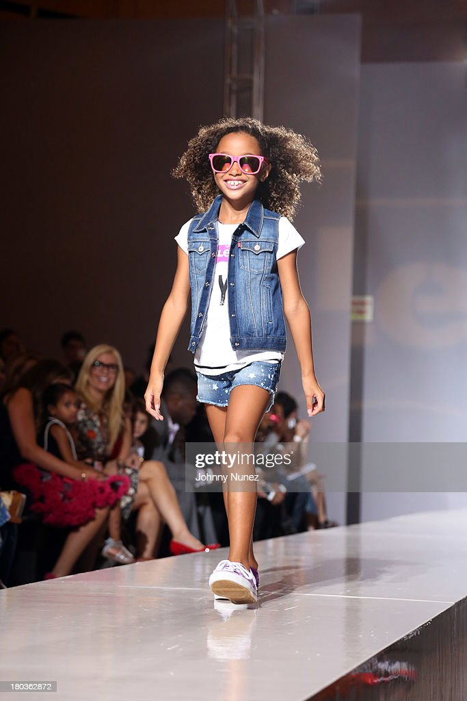 A young model walks the runway at the Kids Rock! Celebrity Fashion Show at Grand Central Terminal on September 11, 2013 in New York City.