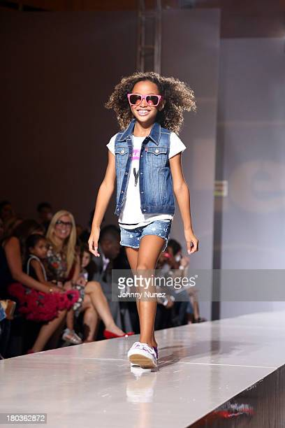 A young model walks the runway at the Kids Rock Celebrity Fashion Show at Grand Central Terminal on September 11 2013 in New York City
