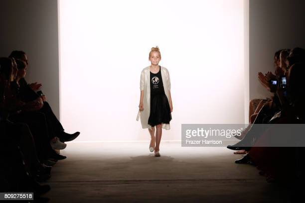 A young model walks the runway at the Maisonnoee show during the MercedesBenz Fashion Week Berlin Spring/Summer 2018 at Kaufhaus Jandorf on July 5...
