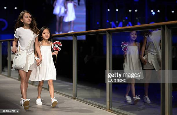 Young models present creations by Mango during the 080 Barcelona 'AutumnWinter 20142015' fashion week in Barcelona on January 27 2014 AFP PHOTO /...