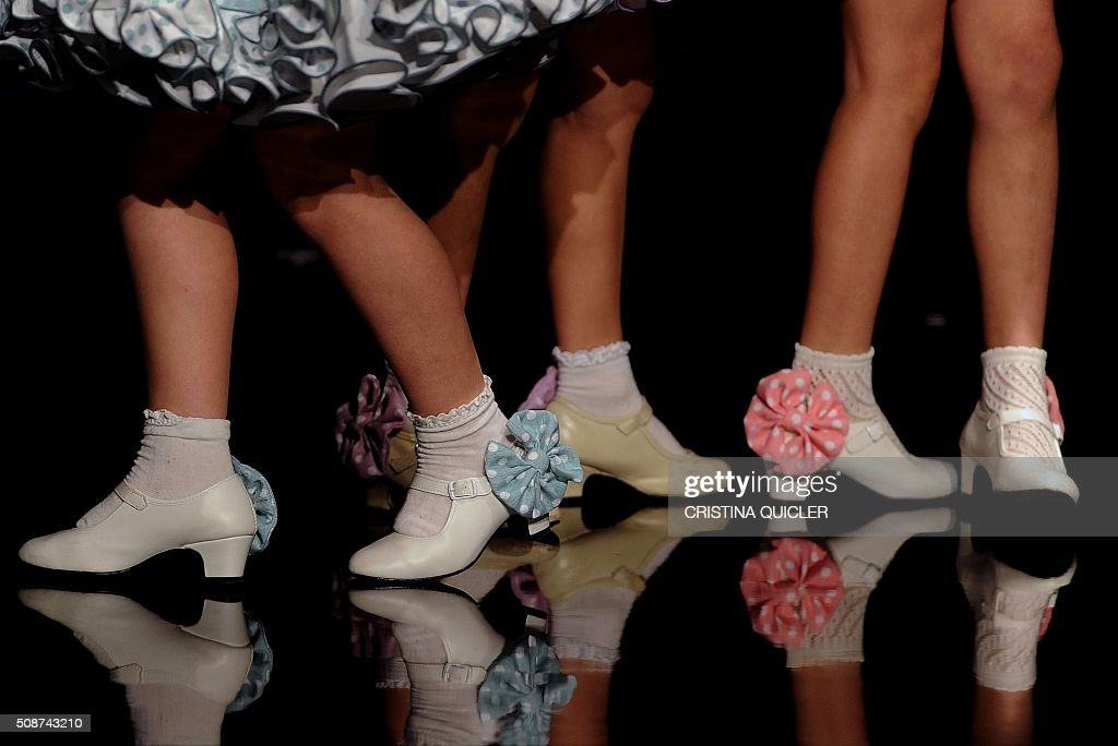 Young models present creations by Sara de Benitez during the SIMOF 2016 (International Flamenco Fashion Show) in Sevilla on February 5, 2016. AFP PHOTO/ CRISTINA QUICLER / AFP / CRISTINA QUICLER
