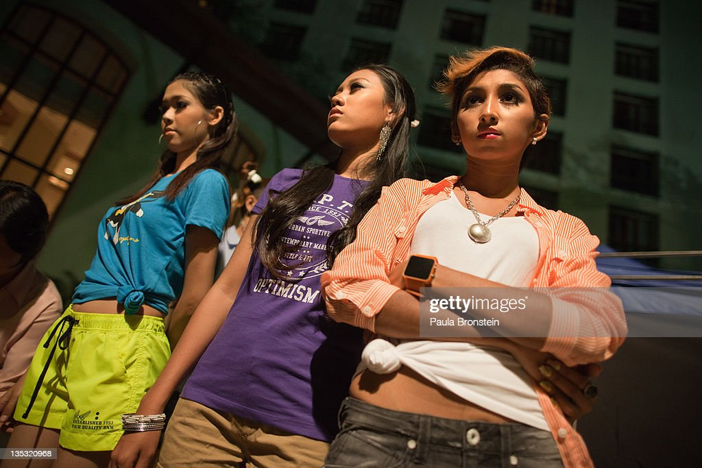 Young models wait backstage for the show to start featuring OPT jeans December 8, 2011 in Yangon, Myanmar. The pace of change in Myanmar brought U.S Secretary of State Hillary Clinton to the country where she discussed further paths to reform and crucial talks with both Aung San Suu Kyi and the highest levels of the Burmese government. For many years Myanmar has suffered from economic stagnation, political repression and international isolation. In March the army handed power to a civilian government after almost five decades of the military regime's strong arm rule. The handover took place after a controlled election under a new constitution that preserved much of the military clout. Internet has been loosened up as previously inaccessible foreign news and opposition websites have been unblocked.