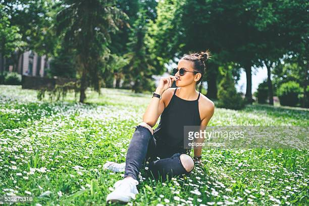 young modern attractive womarn resting at the park