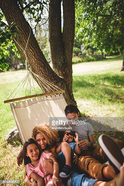 Young modern family enjoying lazy family day in the sun.