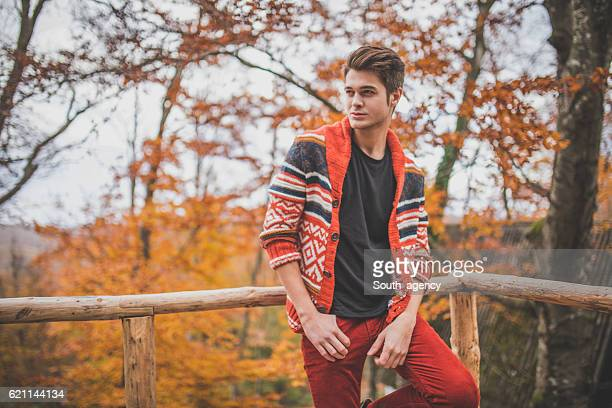 Young modern guy in the forest