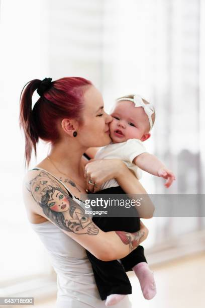 Young Modern Mother with her baby girl