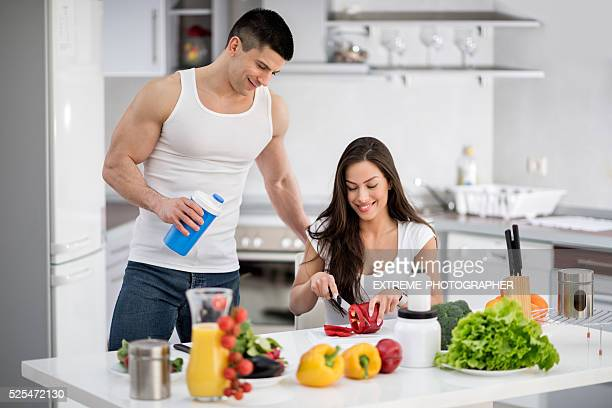Young modern people in the kitchen