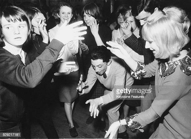 Young mods dancing during a recording of the British pop music TV programme 'Ready Steady Go' London February 1964 On the right is resident fulltime...