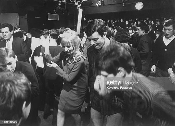 Young mods dancing during a recording of the British pop music TV programme 'Ready Steady Go' London February 1964 At centre are resident fulltime...