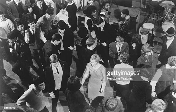 Young mods dancing during a recording of the British pop music TV programme 'Ready Steady Go' at the Rediffusion studios in Kingsway London May 1964