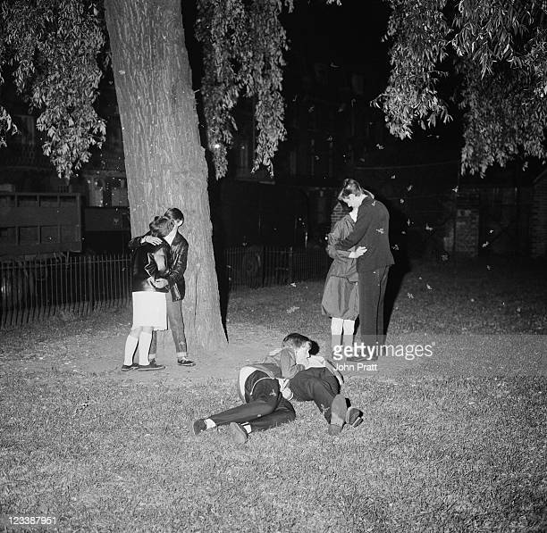 Young Mods kissing in a park in London 1964