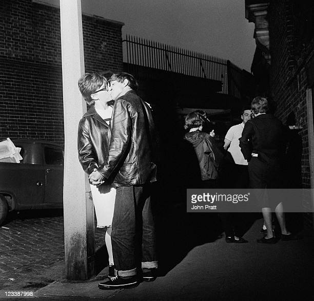 Young Mods kissing in the street in London 1964
