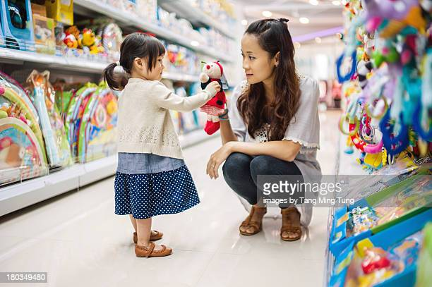 Young mom & toddler playing with puppet doll toy