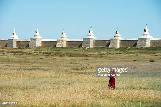 A young monk is walking inside the Erdene Zuu monastery in Kharakhorum Mongolia