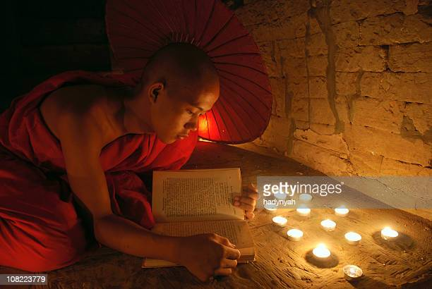 Young monk reading a book