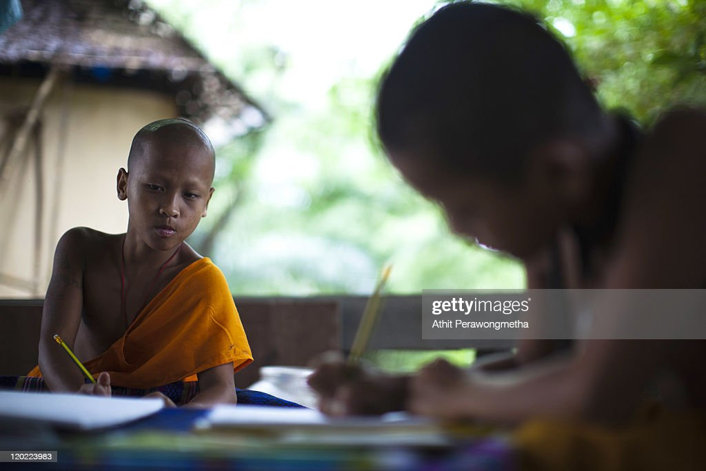 Young monks attend a Thai language class at The Golden Horse Monastery at The Golden Horse Monastery at the Golden Horse Monastery (Wat Tam Pa Ar-Cha Thong) on August 1, 2011 in Chiang Rai, Thailand. The monastery, founded by former Thai boxing champion Phra Kru Ba Neua Chai who became a Buddhist monk , takes in destitute children, training them in equestrian skills on horses, many of which have been saved from slaughterhouses, and Thai boxing. .