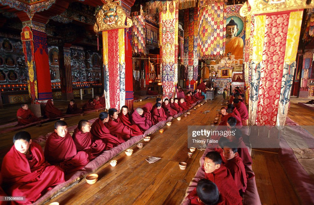 Young monks gathered for a prayer in the sanctuary of the Tawang monastery