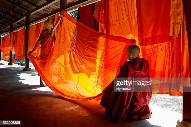 Young Monks Hanging Out Robes To Dry