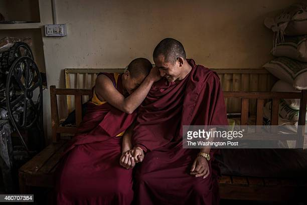 Young monks share a moment of joy in the temple in McLeod Ganj Dharamshala Himachal Pradesh India