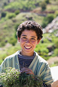 Young Moroccan boy (10-13) selling herbs, portrait