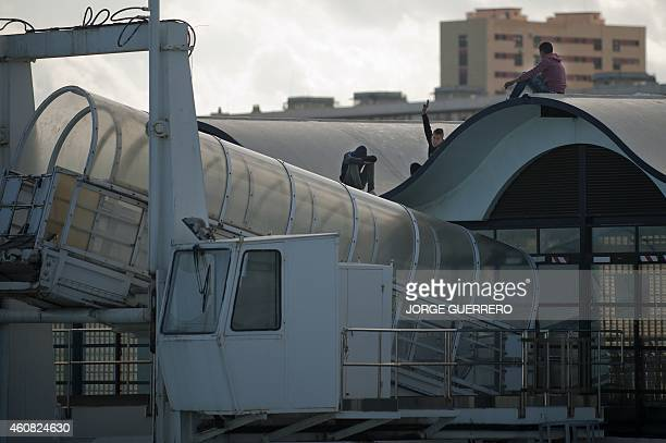 PARRY Young Moroccans wait on the roof of the port of Ceuta to jump a boat and cross the strait on December 5 2014 Thousands are risking their lives...