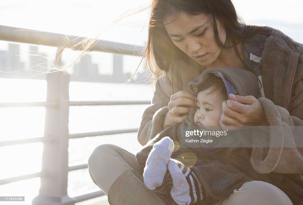 young mother and baby boy at the waterfront : Stock Photo