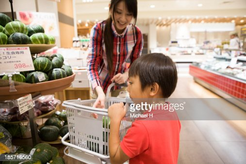 young mother and child at green-grocer