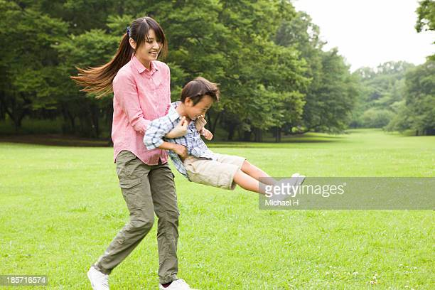 young mother and child having fun in the park