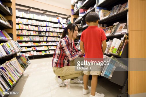 young mother and child in bookstore : Stock Photo