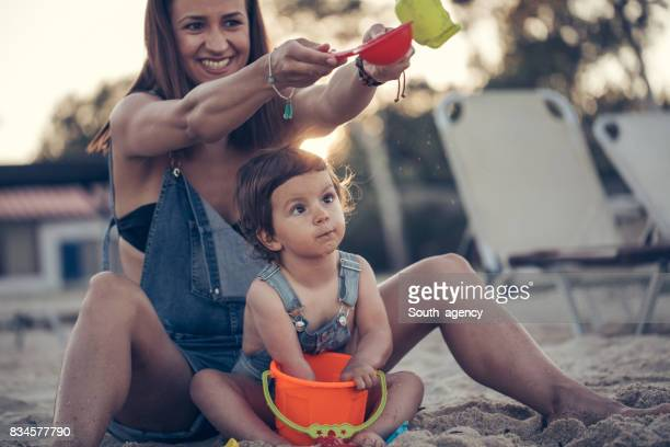 Young mother and daughter at the beach